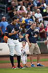 Reno Aces&rsquo; Carlso Rivero and fans listen to the National Anthem before a game at Greater Nevada Field in Reno, Nev., on Sunday, July 17, 2016.<br />Photo by Cathleen Allison
