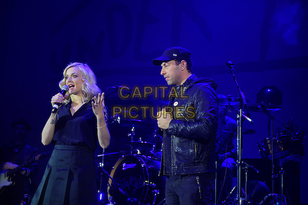 LONDON, ENGLAND - December 19: Fearne Cotton and Chris Martin present the 'Under 1 Roof' Charity Concert at the Eventim Apollo on December 19, 2013 in London, England