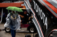 Sept. 20, 2013; Ennis, TX, USA: An NHRA fan walks through the pits during a rain delay to the Fall Nationals at the Texas Motorplex. Mandatory Credit: Mark J. Rebilas-