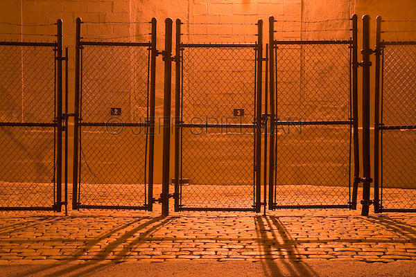 AVAILABLE FROM PLAINPICTURE FOR COMMERCIAL AND EDITORIAL LICENSING. Please go to www.plainpicture.com and search for image # p5690162.<br /> <br /> Fence at Night on Cobblestone Street, Brooklyn, New York City, New York State