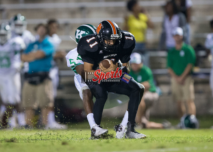 Damian Bertino (11) of the Northwest Cabarrus Trojans is tackled from behind by Cinsere Allison (5) of the A.L. Brown Wonders during second half action at Trojan Stadium September 4, 2015, in Concord, North Carolina.  The Wonders defeated the Trojans 56-7.  (Brian Westerholt/Sports On Film)