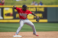 Memphis Redbirds second baseman Jermaine Curtis #23 turns a double play during the Pacific Coast League baseball game against the Round Rock Express on April 27, 2014 at the Dell Diamond in Round Rock, Texas. The Express defeated the Redbirds 6-2. (Andrew Woolley/Four Seam Images)
