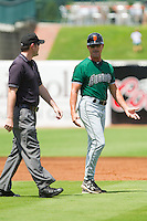 Augusta GreenJackets manager Mike Goff (9) argues a call with base umpire Scott Costello during the South Atlantic League game against the Greensboro Grasshoppers at NewBridge Bank Park on August 11, 2013 in Greensboro, North Carolina.  The GreenJackets defeated the Grasshoppers 6-5 in game one of a double-header.  (Brian Westerholt/Four Seam Images)
