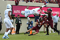 BLACKSBURG, VA - OCTOBER 19: Dazz Newsome #5 of the University of North Carolina scores a touchdown while being flipped over Caleb Farley #3 of Virginia Tech during a game between North Carolina and Virginia Tech at Lane Stadium on October 19, 2019 in Blacksburg, Virginia.