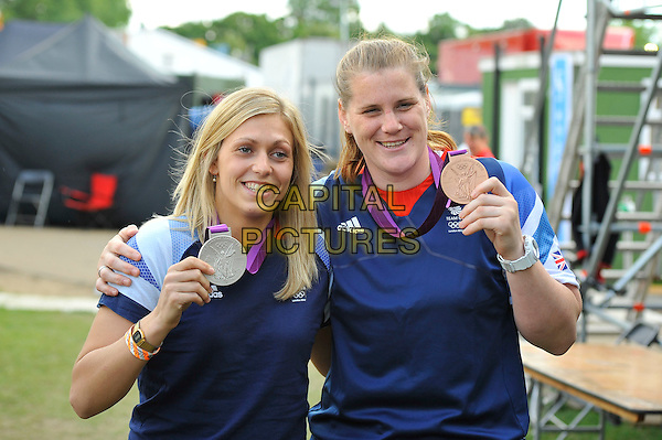 Gemma Gibbons and Karina Bryant of Team GB .attending BT London Live, Hyde Park, London, England, UK, .4th August 2012..Olympics Great Britain half length medal team top t-shirt medals bronze silver medalists .CAP/MAR.© Martin Harris/Capital Pictures.