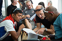 26 SEP 2013 - LANDS END, GBR - Dipankar Paul (front left) studies the race route maps with his support crew at the race briefing before the start of the Enduroman 2013 Lands End to London to Dover ultra triathlon at Lands End, Sennen, Cornwall, Great Britain (PHOTO COPYRIGHT © 2013 NIGEL FARROW, ALL RIGHTS RESERVED)