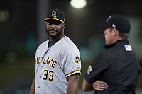 Salt Lake Bees first baseman Chris Carter (33) talks to first base umpire Clay Park during a Pacific Coast League game against the Fresno Grizzlies at Chukchansi Park on May 14, 2018 in Fresno, California. Fresno defeated Salt Lake 4-3. (Zachary Lucy/Four Seam Images)