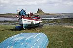 Fishing boat and castle, Holy Island, Lindisfarne, Northumberland, England, UK