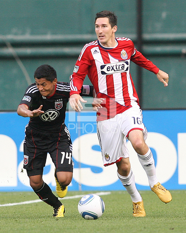 Andy Najar #14 of D.C. United pushes into Sacha Kljestan #16 of Chivas USA during an MLS match at RFK Stadium, on May 29 2010 in Washington DC. United won 3-2.