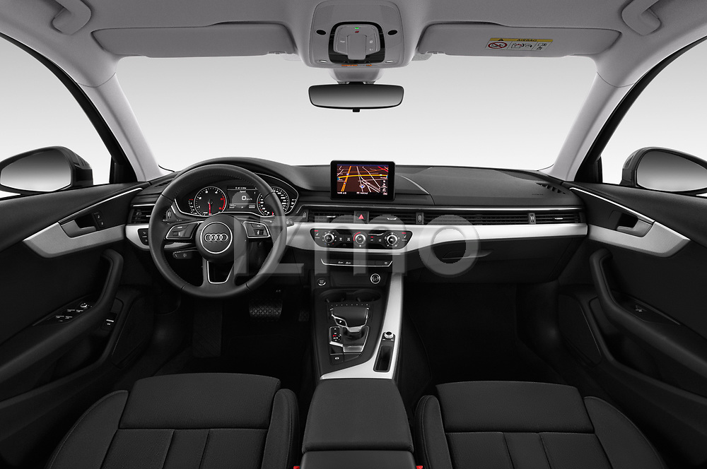 Stock photo of straight dashboard view of a 2018 Audi A4 Avant Sport 5 Door Wagon