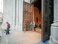 Visitors leave St. Patrick's Cathedral on Fifth Avenue in New York on Tuesday, September 15, 2015. Pope Francis, the Holy Father, will pray at the Vespers Service in the Cathedral on Sept. 24th during his U.S. visit. In New York he will visit Central Park and lead a mass at Madison Square Garden. The Pope will be in the U.S. from Sept. 22 visiting Washington DC, New York and Philadelphia.  (© Richard B. Levine)
