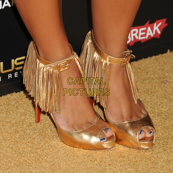 "Aubrey O'Day's shoes.""Deus Ex: Human Revolution"" Launch Party held at The Roxbury, Hollywood, California, USA..August 23rd, 2011.detail feet heels gold peep toe tassels fringe black white nail varnish polish striped stripes.CAP/ADM/BP.©Byron Purvis/AdMedia/Capital Pictures."