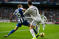 Real Madrid´s Cristiano Ronaldo and Deportivo de la Coruna's Laureano Sanabria Ruiz during 2014-15 La Liga match between Real Madrid and Deportivo de la Coruna at Santiago Bernabeu stadium in Madrid, Spain. February 14, 2015. (ALTERPHOTOS/Luis Fernandez) /NORTEphoto.com