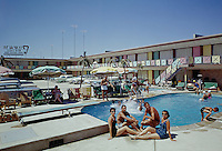 Crown Motel, Wildwood, NJ. Couples sitting by the pool - 1964