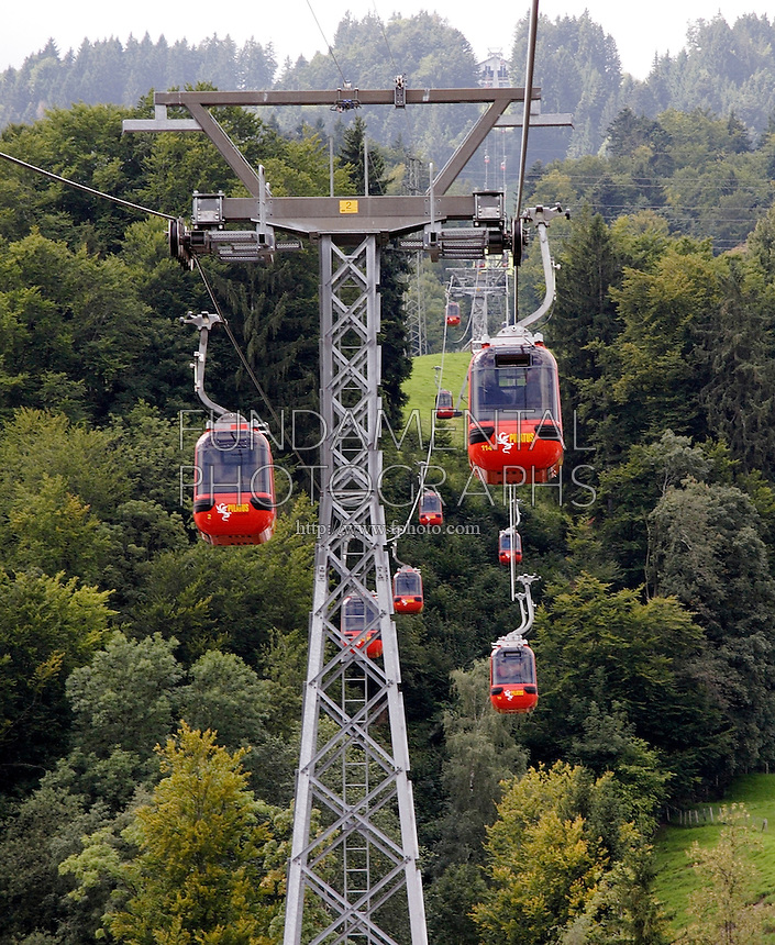 MOUNTAIN TRANSPORTATION<br /> Cable Car Passing Over Supporting Tower<br /> Mt. Pilatus, Switzerland<br /> A cable car is a type of aerial lift which consists of a loop of steel cable that is strung between two stations, over intermediate supporting towers. It utilizes principles of simple machines- pulleys, gears and levers.