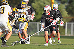 Palos Verdes, CA 03/30/10 - Andrew Castillo (Peninsula #14) and Wesley Hebert (Palos Verdes #32) in action during the Palos Verdes-Peninsula JV Boys Lacrosse game.