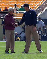 VT head coach Frank Beamer (left) and Pitt head coach Paul Chryst shake hands before the game. The Pitt Panthers defeated the Virginia Tech Hokies 35-17 at Heinz field in Pittsburgh, PA on September 15, 2012.