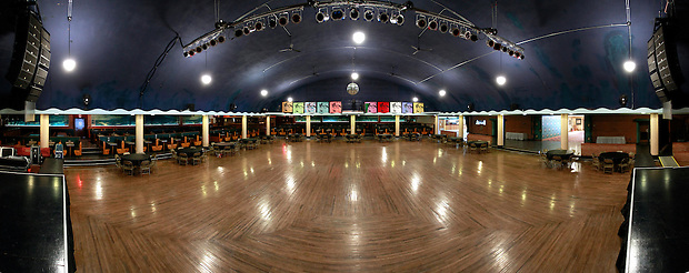 1/19/12 12:37:54 PM -- Clear Lake, IA, U.S.A. -- THIS IS FOR A LIFE COVER:.A 180 degree view of the Surf Ballroom as seen from the stage in a panoramic composite from multiple photographs..On Feb. 3, 1959, Buddy Holly, Ritchie Valens and the Big Bopper died when their plane crashed in a farm field north of Clear Lake, Iowa ? an event memorialized as ?the day the music died? in the 1971 song American Pie by Don McLean. The three 1950s stars played their last gigs at Clear Lake?s Surf Ballroom, which is intact today and holds an annual celebration of its moment in music history. The ballroom, largely the same as it was in its ?50s heyday, struggled as a for-profit business and has been operated as a non-profit since 2008. It hosts concerts, weddings, reunions and school tours. It has a small museum, but the big draw is the place itself. The maple dance floor and booths are original. One of the two original coat checks is still there and so is the phone that Holly used to call his wife before the fatal crash, the website boasts. The fun part is the annual gathering of fans from all over the world, which this year is Feb. 1-4 and is delicately called the ?winter dance party.? There are concerts each night, a bus outing to the crash site, which is marked by a giant pair of the glasses Holly wore, dance lessons, video and art contests and a gathering of the British Buddy Holly Society (whose members have been coming to Clear Lake for 23 years). Chuck Berry is a featured performer this year. It?s a charming and weird slice of Iowa life and rock ?n? roll history. -- ...Photo by Christopher Gannon for USA TODAY.