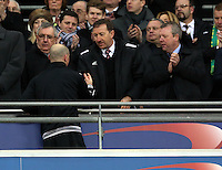 Pictured: Swansea City FC chairman Huw Jenkins (C) with board member Martin Morgan (R) greet Bradford players on the stadium balcony. Sunday 24 February 2013<br /> Re: Capital One Cup football final, Swansea v Bradford at the Wembley Stadium in London.