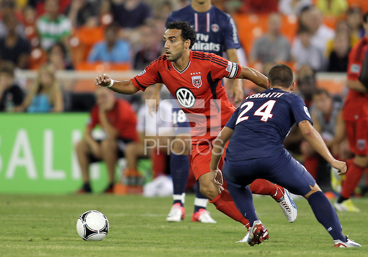 WASHINGTON, DC - July 28, 2012:  Dwayne DeRosario (7) of DC United gets away from Marco Verratti (24) of PSG (Paris Saint-Germain) in an international friendly match at RFK Stadium in Washington DC on July 28. The game ended in a 1-1 tie.