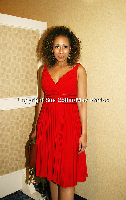 Tamara Tunie - ATWT & Law & Order SVU is presented the Linda Dano Heart Award by Linda Dano at the HeartShare 2010 Spring Gala and Auction on March 25, 2010 at the New York Marriott Marquis, New York City, New York. (Photo by Sue Coflin/Max Photos)