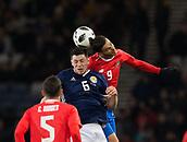 23rd March 2018, Hampden Park, Glasgow, Scotland; International Football Friendly, Scotland versus Costa Rica; Yendrick Ruiz of Costa Rica competes in the air with Scott McKenna of Scotland