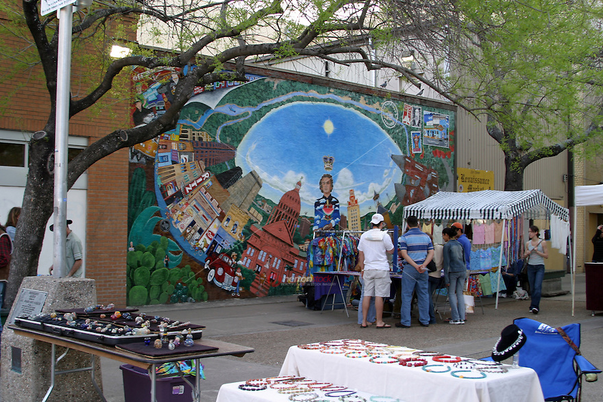 Students browse the local artisans at the 23rd Street Renaissance Market on the drag across the street from the UT campus on Guadalupe Street in Austin, Texas, USA