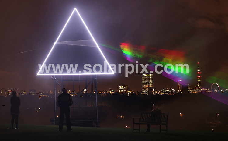 **ALL ROUND PICTURES FROM SOLARPIX.COM**.**NO UK NEWSPAPER PUBLICATION**.**UK MAGAZINE & SUPPLEMENT PUBLICATION ONLY** AND NO PUBLICATION IN AUSTRALIA, FRANCE, GERMANY, ITALY AND SCANDINAVIA** .Pink Floyd's Album Cover recreated - As the sun set over Primrose Hill last night a new addition to the spectacular view of the London skyline came to life...Sky Arts paid tribute to Pink Floyd's iconic Dark Side Of The Moon album cover to coincide with the screening of the band's 1994 live performance of the album, on Sky Arts 1 HD and Sky Arts 1 this Friday...Created using a pyramid structure, LED lighting and powerful light lasers, the spectrum beamed out across the night sky, bringing to life one of the most famous album covers in history. London, UK. 21 October 2009..This pic: Pink Floyd laser..JOB REF: 10161 SFE       DATE: 21_10_2009.**MUST CREDIT SOLARPIX.COM OR DOUBLE FEE WILL BE CHARGED**.**MUST NOTIFY SOLARPIX OF ONLINE USAGE**.**CALL US ON: +34 952 811 768 or LOW RATE FROM UK 0844 617 7637**