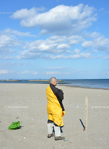 March 11, 2013, Sendai, Japan - An ascetic monk offers silent tribute to those perished in the March 11, 2011 disaster on a beach by the Pacific Ocean in Sendai, Miyagi Prefecture, on Monday, March 11, 2013, as the nation observes the second anniversary of the country's worst catastrophe.  (Photo by Natsuki Sakai/AFLO)
