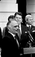 Washington, DC., USA, February 13, 1984<br /> President Ronald Reagan with King Hussein II of Jordan at the South Portico of the White House at the conclusion of their meeting. Credit: Mark Reinstein/MediaPunch