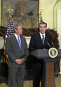 United States President George W. Bush names Carlos Gutierrez, Chief Executive Officer, Kellogg Company, as United States Secretary of Commerce replacing Donald Evans in the Roosevelt Room of the White House on November 29, 2004. <br /> Credit: Ron Sachs / CNP