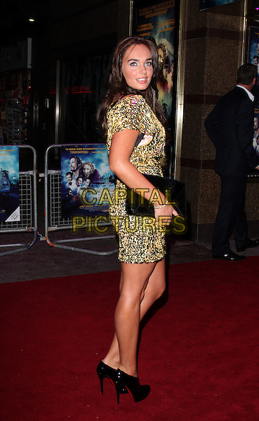 "TAMARA ECCLESTONE .Attending the UK film premiere of ""The Imaginarium Of Doctor Parnassus"" at the Empire Leicester Square cinema, London, England, UK, October 6th 2009..full length gold sequined sequin dress hand on hip black patent booties boots shoe ankle shooboots christian louboutin heels high wrist watch clutch bag looking back over shoulder over shoulder .CAP/ROS.©Steve Ross/Capital Pictures"