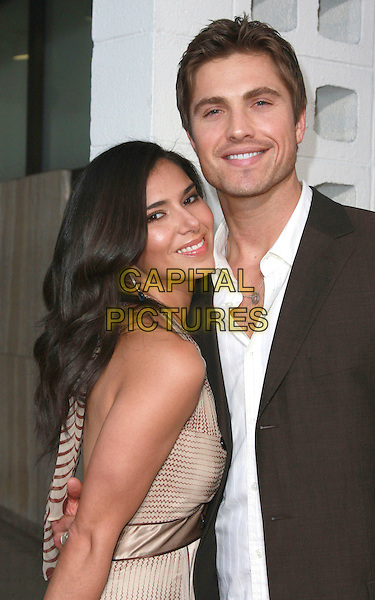 "ROSELYN SANCHEZ & ERIC WINTER .""Harold and Kumar Escape From Guantanamo Bay"" Los Angeles Premiere held at the ArcLight Cinerama Dome Theatre, Hollywood, California, USA, 17 April 2008..half length.CAP/ADM/`CH.©Charles Harris/Admedia/Capital PIctures"
