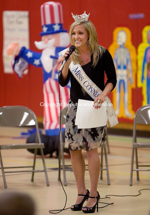 NAUGATUCK, CT. 17 September 2010-091710SV01--Miss. Connecticut Brittany Decker sings a constitution song for students at Maple Hill Elementary School in Naugatuck Friday. The school was celebration constitution day with a special program. Several local and state dignitaries were on hand for the event. <br /> Steven Valenti Republican-American