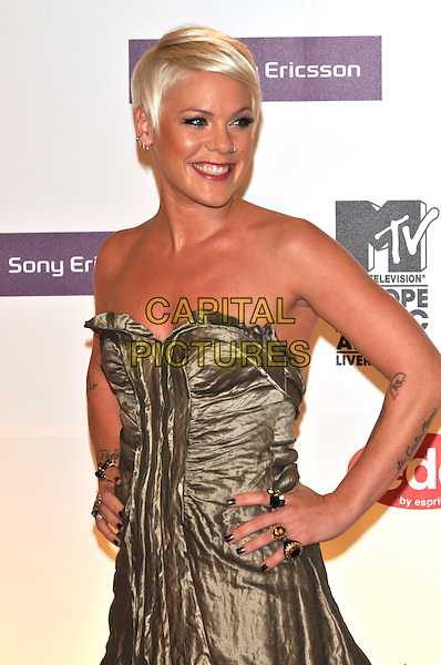PINK.2008 MTV Europe Music Awards arrivals at Echo Arena, Liverpool, England..6th November 2008.EMA half length strapless gold dress hands on hip pinnk tattoos nail varnish polish .CAP/PL.©Phil Loftus/Capital Pictures.