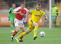 AFC Wimbledon's Joe Pigott under pressure from Fleetwood Town's Jordan Rossiter<br /> <br /> Photographer Kevin Barnes/CameraSport<br /> <br /> The EFL Sky Bet Championship - Fleetwood Town v AFC Wimbledon - Saturday 10th August 2019 - Highbury Stadium - Fleetwood<br /> <br /> World Copyright © 2019 CameraSport. All rights reserved. 43 Linden Ave. Countesthorpe. Leicester. England. LE8 5PG - Tel: +44 (0) 116 277 4147 - admin@camerasport.com - www.camerasport.com