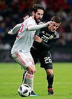 Spain's Isco Alarcon (l) and Argentina's Fabricio Bustos during international friendly match. March 27,2018. *** Local Caption *** © pixathlon<br /> Contact: +49-40-22 63 02 60 , info@pixathlon.de