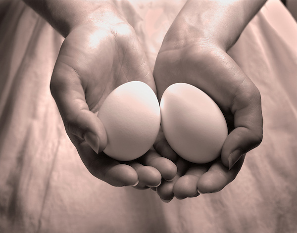 Two eggs in hands