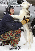 Saturday, March 3, 2012 Musher Sylvia Furtwangler's handler, Bob Steiner, and one of her dogs, O2, along Fourth Avenue prior to the Ceremonial Start of Iditarod 2012 in Anchorage, Alaska.