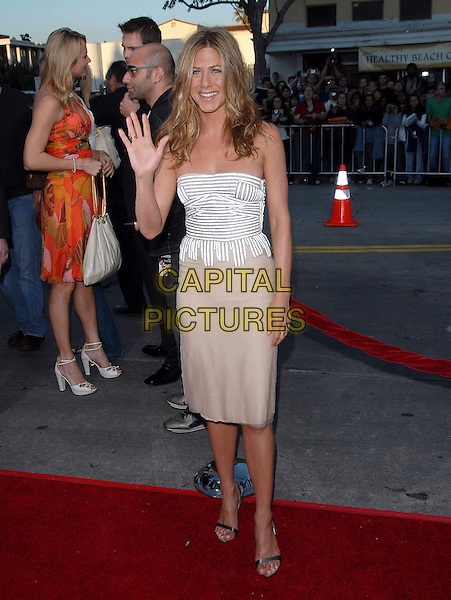 """JENNIFER ANISTON.At The Universal Pictures' World Premiere of .""""The Break Up"""" held at The Mann's Village Theatre, Westwood, California, USA, May 22, 2006..full length striped strapless top skirt white beige hand waving.Ref: DVS .www.capitalpictures.com.sales@capitalpictures.com.©Debbie VanStory/Capital Pictures"""