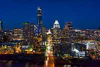 Austin Downtown Skyline -  This is another of our aerial  image of Austin skyline from the Congress Bridge.  You can see the Texas Capital as it is now dwarfed compared to all the high rise skyscrapers that have been built within the last then years that now tower over it.  That why I wanted this image because it is one of the few to show the city and the capital together.  The Frost was the first tall building and then came the tallest building in Austin the Austonian with many soon to join the skyline along the shore.   All the newest high rise structures are being built along Lady Bird Lake so our skyline along the lake is constantly changing but this image should not change radically for a while.