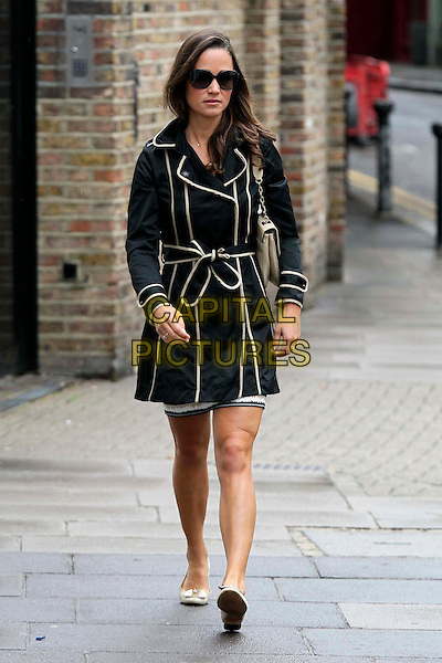 Pippa Middleton spotted near her home, London, England..August 26th, 2011.full length black white trim mac trench coat jacket sunglasses shades pumps shoes flats.CAP/HIL.©John Hillcoat/Capital Pictures .