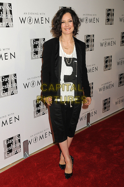 "Sara Gilbert.LA Gay & Lesbian Center's ""An Evening With Women"" 2013 held at the Beverly Hilton Hotel, Beverly Hills, California, USA, 18th May 2013..full length black jacket cropped trousers white top .CAP/ADM/BP.©Byron Purvis/AdMedia/Capital Pictures"