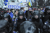 "Supporters of president Yanukovich near the building of Parliament cheering ""go back to work"" to demontrators. It is widely known that most of people who go on the streets to support current government are paid daily around 20 US dollars. Their meetings are usually guarded by Police to prevent violence between two sides of protesters."