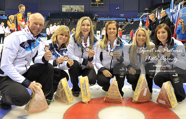 (l to r) coach Glenn Howard, Lauren Gray, Vicki Adams, Anna Sloan and Eve Muirhead with  their bronze medals and cheese. Mens final. Le Gruyère AOP European Curling Championships 2016. Intu Braehead Arena. Glasgow. Renfrewshire. Scotland. UK. 26/11/2016. ~ MANDATORY CREDIT Garry Bowden/Sport in Pictures - NO UNAUTHORISED USE - +447837 394578