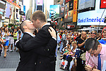 We Love Soaps Kevin Mulcahy Jr and Rogert Newcomb kiss at end of wedding on August 18, 2012 in Times Square, New York City, New York. (Photos by Sue Coflin/Max Photos)