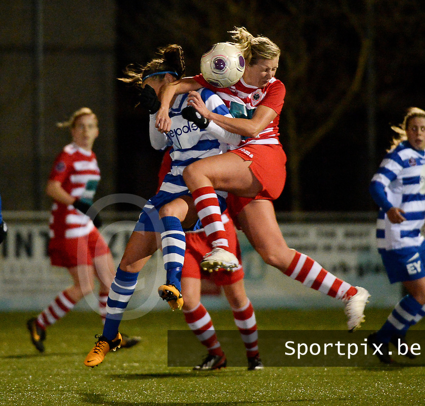20140221 - OOSTAKKER , BELGIUM : duel pictured between Gent Jassina Blom (l) and Antwerp Sophie Mannaert (r) during the soccer match between the women teams of AA Gent Ladies  and RAFC Antwerp Ladies , on the 19th matchday of the BeNeleague competition Friday 21 February 2014 in Oostakker. PHOTO DAVID CATRY
