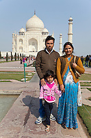 Agra, India.  Indian Couple and Daughter Visiting the Taj Mahal.  The woman wears a blue bindi above her nose, a Hindu symbol representing the third eye, or spiritual sight which Hindus seek to awaken.