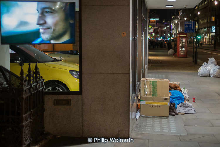 Rough sleepers outside a luxury car showroom, Piccadilly, London.