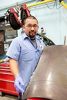 Daniel Medrano repairs edge damage to a mold
